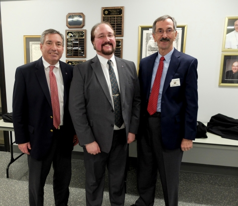 Pictured: Grand Knight Rick Witty, Rolfe Trimble and Membership Director Gary Port.